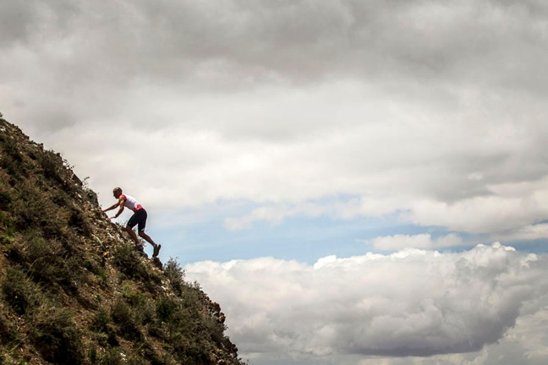 Casey Morgan ascends Devil's Ridge, Gobi Desert, China. Photo By Zandy Mangold.